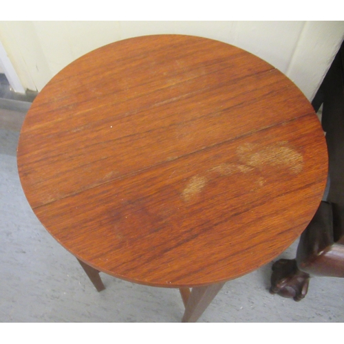 4 - A nesting set of four 1970s folding teak occasional tables with oval tops, suspended from a 'parent'...