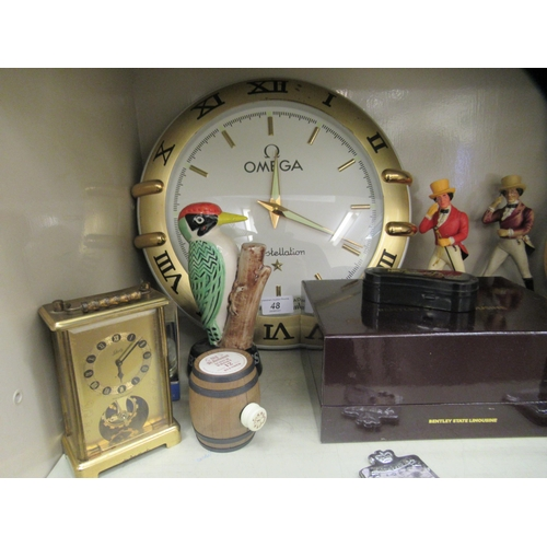 48 - Promotional wares for breweries, cars and others: to include a quartz timepiece, the dial fashioned ...