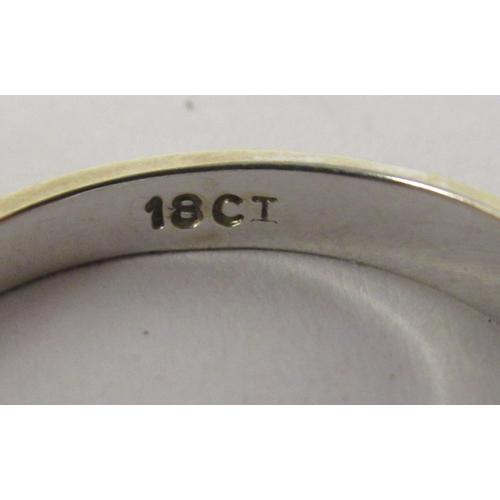 54 - An 18ct white gold seven stone diamond ring