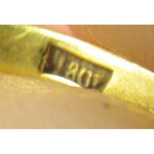8 - An 18ct gold single stone diamond ring