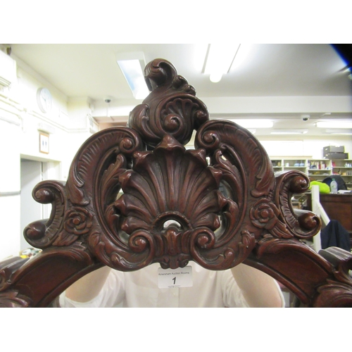 1 - A late Victorian/Edwardian mahogany framed cheval mirror, the oval plate within an ornately carved f...