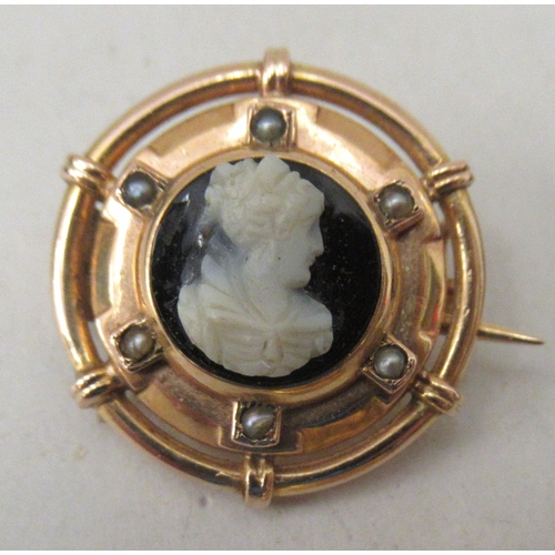 14 - Six Victorian and later gold and yellow metal mourning and other brooches: to include a 15ct gold ba...