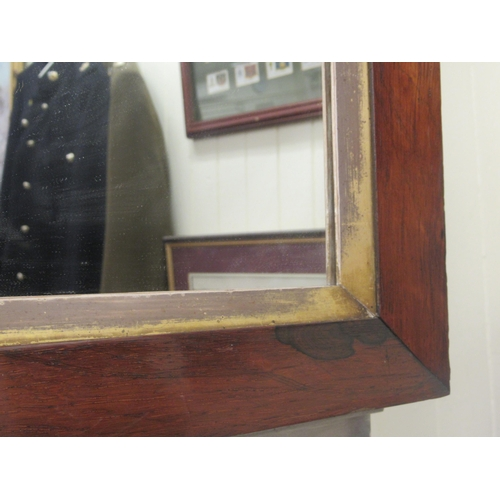 15 - A 20thC mirror plate, set in a Regency rosewood finished frame 18