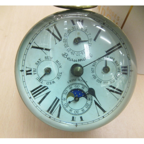 16 - A 20thC lacquered brass and glazed desktop timepiece; faced by a Beaumont of Switzerland dial with d...