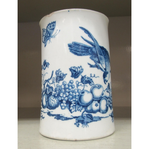 23 - A late 18thC Royal Worcester porcelain cylindrical tankard, decorated in blue and white with a parro...