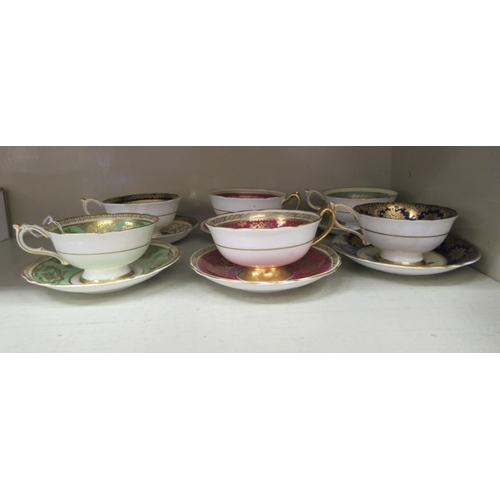 36 - A set of six Paragon china cups and saucers, each decorated with floral designs and gilding with dif...