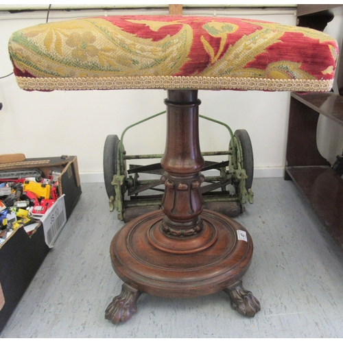 47 - A William IV rosewood stool with a tapestry upholstered top over a tulip carved column, on lion paw ...