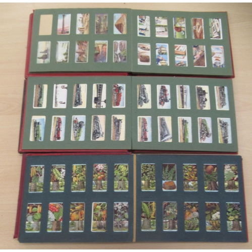 53 - Six album collections of Will's cigarette cards: to include early racing cars and railway locomotive...