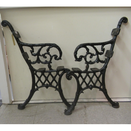 57 - A pair of Victorian style black painted cast iron bench ends