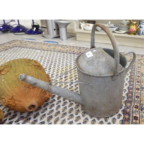 45 - Outdoor items, viz. a galvanised watering can; a cast iron hook; three terracotta wall planters 10