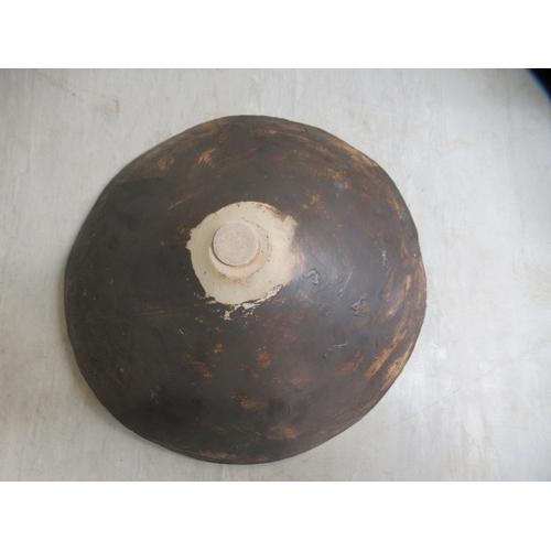 109 - A studio pottery figure, kneeling beside a bowl 16