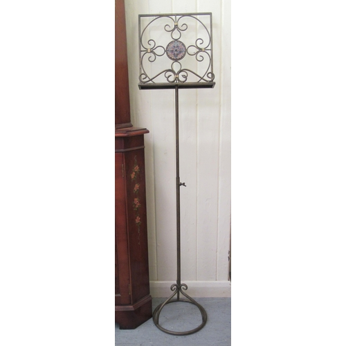 116 - A 20thC freestanding, painted wrought metal, height adjustable music stand 54