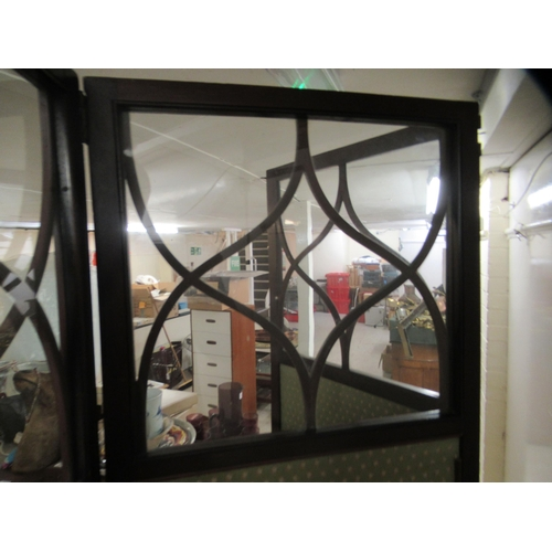 117 - An Edwardian mahogany three fold room screen, the upper panels with astragal glazing, over fabric co...