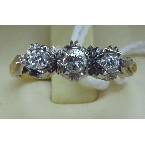 138 - A 18ct gold claw set three diamond ring