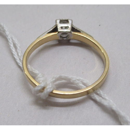 139 - An 18ct bi-coloured gold diamond solitaire ring