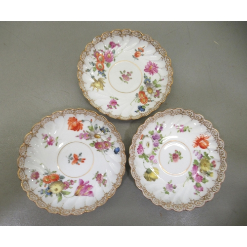194 - A set of three Dresden porcelain cups and saucers, decorated with flora and gilding