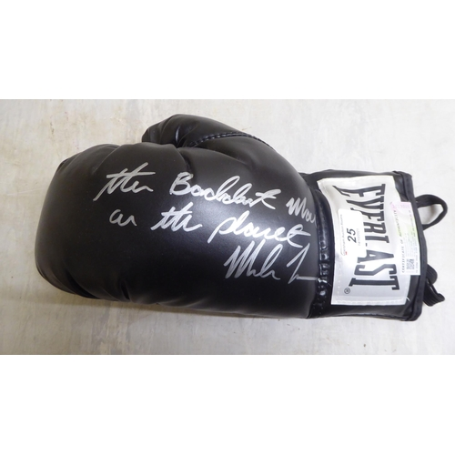 25 - A left hand Everlast boxing glove, signed 'The Baddest Man on the Planet... Mike Tyson' with a certi...