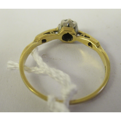 258 - An 18ct gold single stone diamond ring with diamond chip shoulders