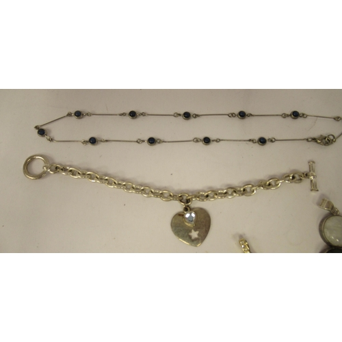267 - Silver and white metal items of personal ornament: to include two bangles and rings variously worke...