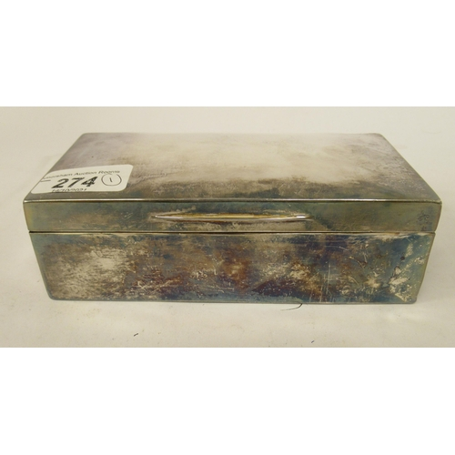274 - A silver cigarette box with straight sides and a hinged lid London 1910 6.5