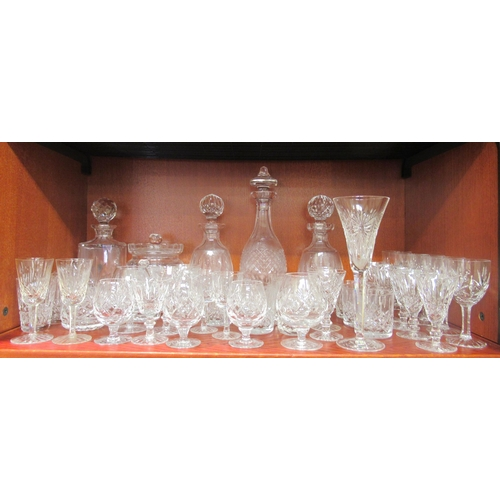 330 - Waterford and other glassware: to include a biscuit barrel; various decanters and pedestal wines