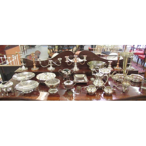 393 - 20thC decorative and functional silver plated tableware: to include single and twin branch candlesti...