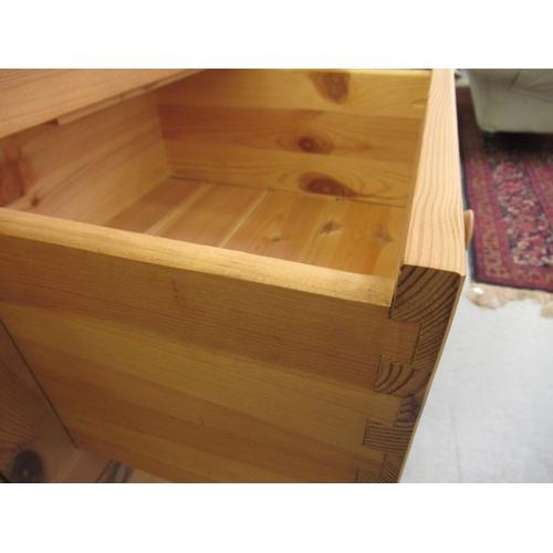 80 - A modern waxed pine five drawer dressing chest, on a plinth 47