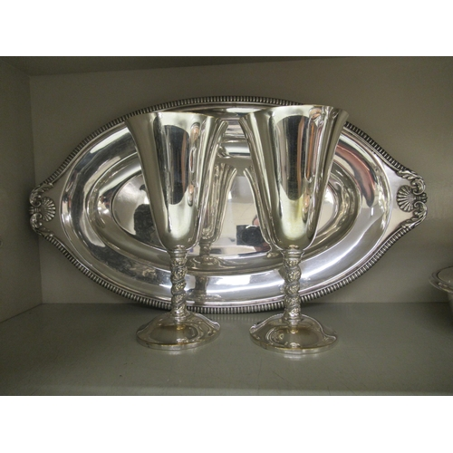186 - Silver plated tableware: to include a Victorian style wine bottle coaster and a claret jug