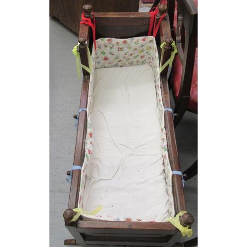131 - A 19thC oak rocking crib 39