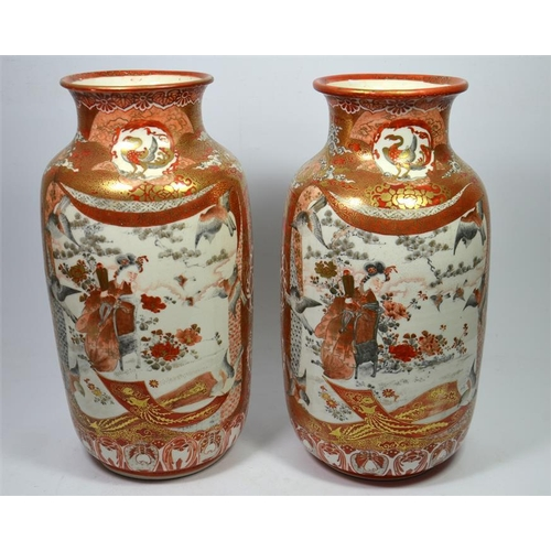 A Pair Of Japanese Kutani Vases Painted With Panels Of Geisha And