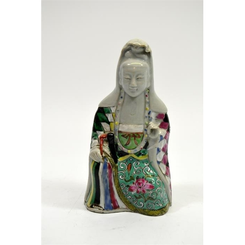 14 - A Chinese famille rose figure of Guanyin, polychrome and blanc de Chine, 20cm high...