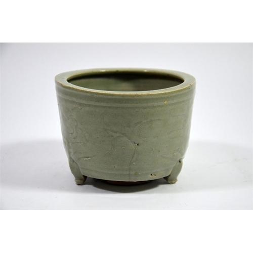 15 - A Chinese celadon censer, incised foliate design, on three feet, 10cm high...