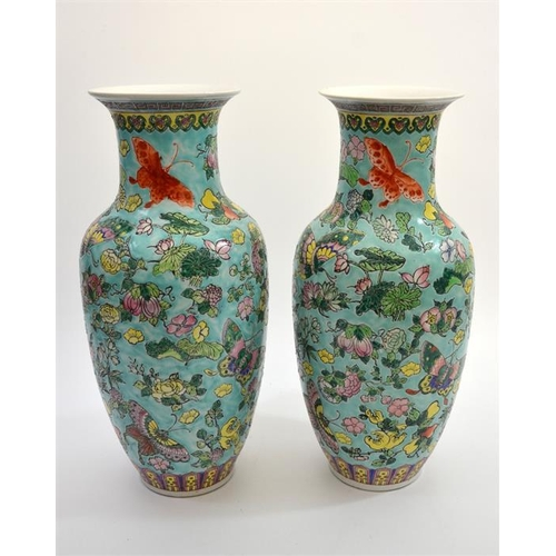 22 - A pair of Chinese porcelain vases, Jiaqing seal mark, famille rose decorated with butterfly and flor...