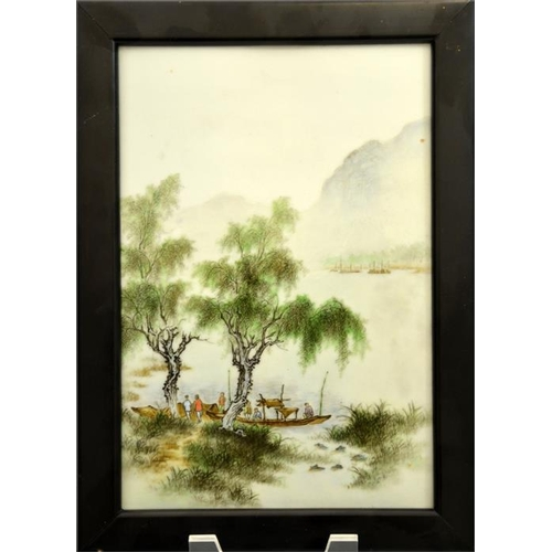 24 - A Chinese famille verte plaque, painted with figures and boats in a watery misty landscape, 25cm x 1...