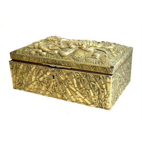 48 - An Oriental box, decorated with chrysanthemums on lid and bamboo on sides, height 10cm, length 26cm,...