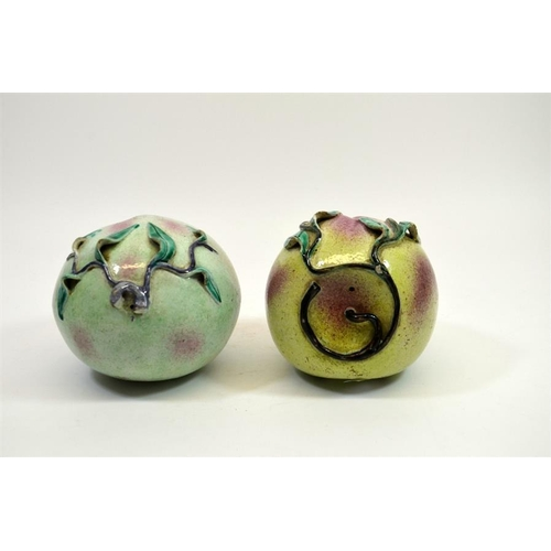 5 - A pair of Chinese porcelain peaches, 19th century, polychrome enamelled, 15cm diameter (2)...