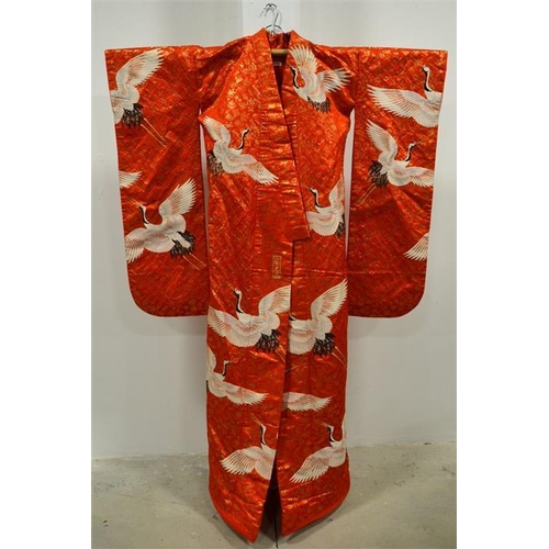 58 - A vintage Japanese large heavy duty silk Uchikake bridal kimono robe, golden red with embroidered cr...