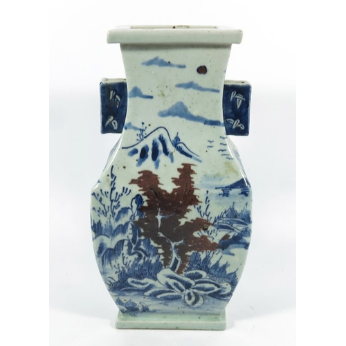 10A - A Chinese blue and white vase, square section baluster form with wing handles, 33cm high...