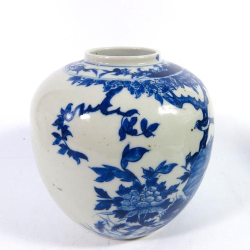 11 - A Chinese blue and white ginger jar, probably Qianlong or later, painted with birds in a tree, doubl...