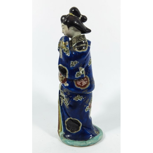 14A - A Japanese Imari figure, modelled as a Geisha, the top section removing to reveal an unclothed lower...