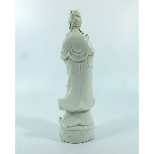 14 - A Chinese Blanc de Chine figure of Guanyin, 18th century, 29cm high...