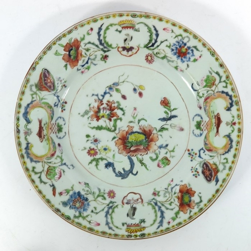 15 - A Chinese famille rose plate, in the Madame de Pompadour pattern, circa 1750, Rococo style cartouche...