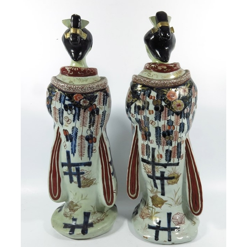 16A - A large pair of Japanese Imari figures, modelled as Geishas, 46cm high (2)...