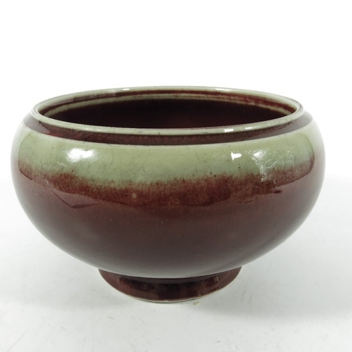 17 - A Chinese flambe bowl, Qing, rounded footed form with incised band to the rim, 16cm diameter...