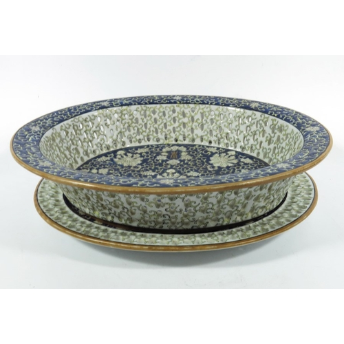 17A - A Chinese reticulated dish and stand, 20th century, in the Qianlong style, 32.5cm long...