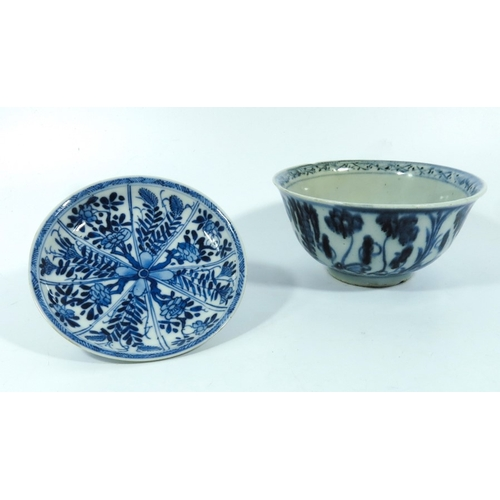 18 - A Chinese blue and white bowl, late Ming, together with a Kangxi saucer, the bowl with floral decora...