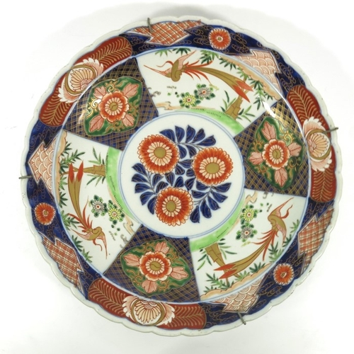 19 - Three Oriental porcelain chargers, including two Japanese Imari plates and a famille rose example, 3...