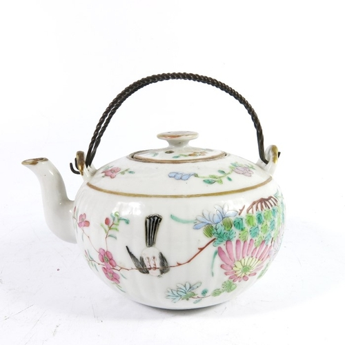 2 - A Chinese famille rose teapot, 18th century, squat ovoid form with relief moulded reeding, twisted w...
