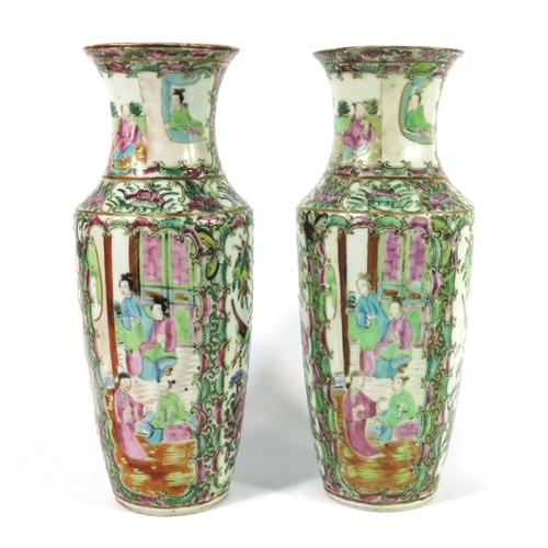 21 - A pair of Chinese famille rose vases, 19th century Cantonese, shouldered form, decorated with panels...