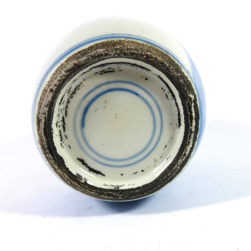 22 - A Chinese blue and white ginger jar, ovoid form, together with a cylindrical pot, 15.5cm high (2)...